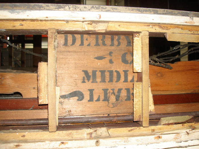 Much of the interor panelling is made from the packing cases that the carriage parts were delivered in.  This appears to be the box addressed to Midland Railway Derby containing livery pack (stencils etc.)