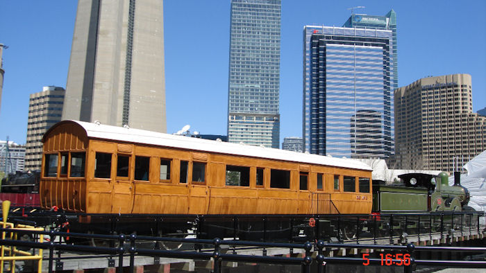 GER No. 3 Directors' saloon in Toronto for 'The Railway Children' - daytime (alongside  London and South Western Railway's No. 563 from the National Railway Museum) - at the base of the famous CN Tower